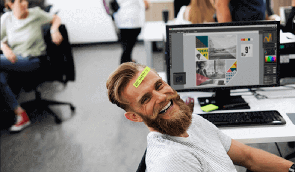 man laughing in office