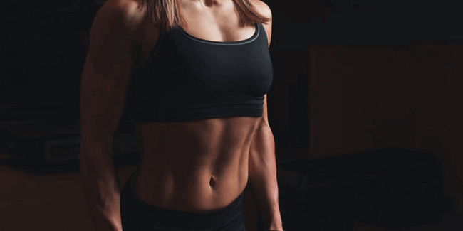 woman showing core muscles